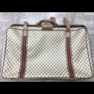 Large Gucci suit case